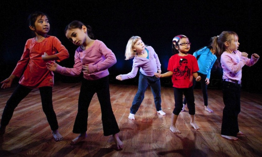 children participating in creative body movement dance class